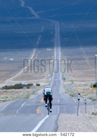 Lonely Bicyclist Going Across Country