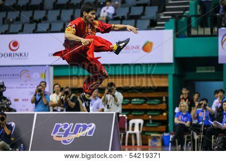 KUALA LUMPUR - NOV 03: Malaysia's Ng Say Yoke executes a high kick in the Men's 'Daoshu' Event at the 12th World Wushu Championship on November 03, 2013 in Kuala Lumpur, Malaysia.