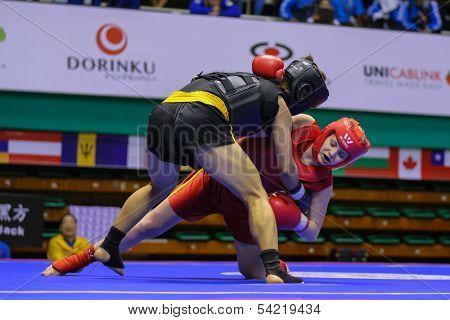 KUALA LUMPUR - NOV 03: Ukraine's Nadiia Chorna (red) fights China's Meng Zin in the Women's < 70kg 'Sanda' event at the 12th World Wushu Championship on November 03, 2013 in Kuala Lumpur, Malaysia.