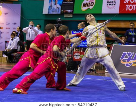 KUALA LUMPUR - NOV 05: Members of Ukraine's dalian team performs a fight scene in the Men's Dual Event at the 12th World Wushu Championship on November 05, 2013 in Kuala Lumpur, Malaysia.