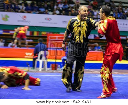 KUALA LUMPUR - NOV 05: Members of Iran's dalian team performs a fight scene in the Men's Dual Event at the 12th World Wushu Championship on November 05, 2013 in Kuala Lumpur, Malaysia.