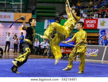 KUALA LUMPUR - NOV 05: Hong Kong's dalian team performs a fight scene in the Men's Dual Event at the 12th World Wushu Championship on November 05, 2013 in Kuala Lumpur, Malaysia.
