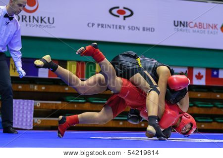 KUALA LUMPUR - NOV 03: Equador's Maria Quispe (red) fights Italy's Antonia Di Biase in the Women's 'Sanda' event of the 12th World Wushu Championship on November 03, 2013 in Kuala Lumpur, Malaysia.