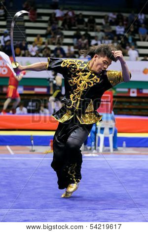 KUALA LUMPUR - NOV 03: Macau's Wu Nok In performs with a sword in the Men's 'Daoshu' Event at the 12th World Wushu Championship on November 03, 2013 in Kuala Lumpur, Malaysia.