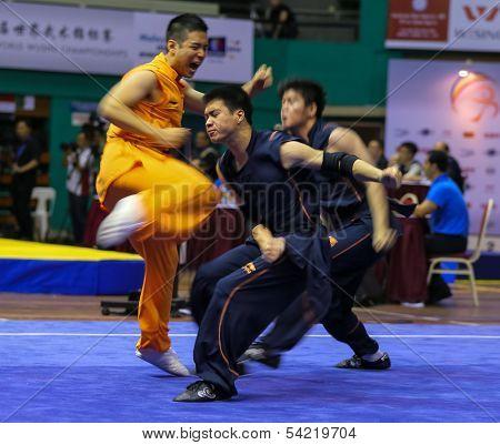 KUALA LUMPUR - NOV 05: Members of Australian dalian team performs a fight scene in the Men's Dual Event at the 12th World Wushu Championship on November 05, 2013 in Kuala Lumpur, Malaysia.