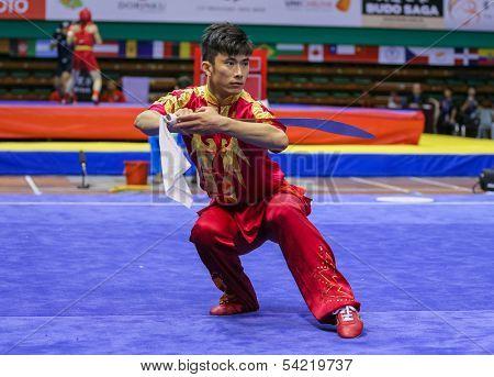 KUALA LUMPUR - NOV 03: Macau's Jia Rui performs with a sword in the Men's 'Daoshu' Event at the 12th World Wushu Championship on November 03, 2013 in Kuala Lumpur, Malaysia.