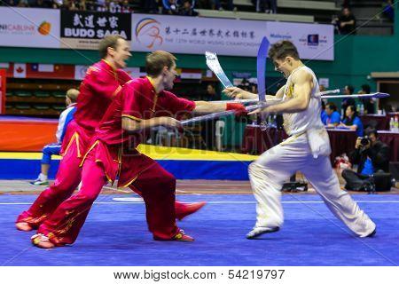 KUALA LUMPUR - NOV 05: Members of Ukraine's dalian team performs a fight scene in the Men's Dual Event at the 12th World Wushu Championship on November 05, 2013 in Kuala Lumpur, Malaysia.