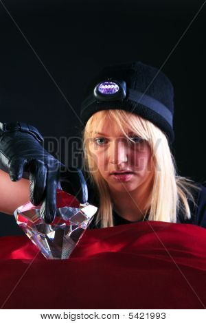 Blond Woman Cat Burglar Stealing A Large Diamond