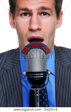 Businessman On The Air Microphone