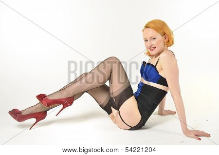 Attractive red head sitting on floor