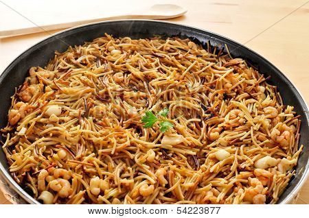a spanish fideua, a typical noodles casserole with seafood