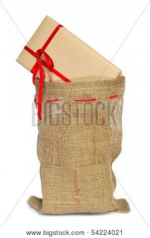 a pile of gifts with a red ribbon in a christmas stocking on a white background