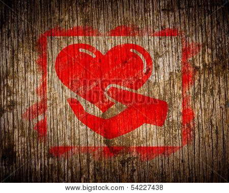 Red Charity Concept Painted by Stencil on Wood.