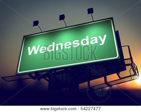 Wednesday - Billboard on the Sunrise Background.