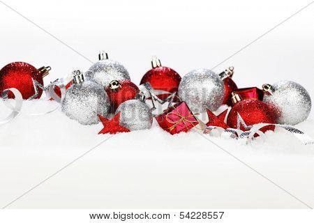Christmas card with decoration and gifts on snow