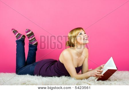 Woman Is Reading On A Carpet