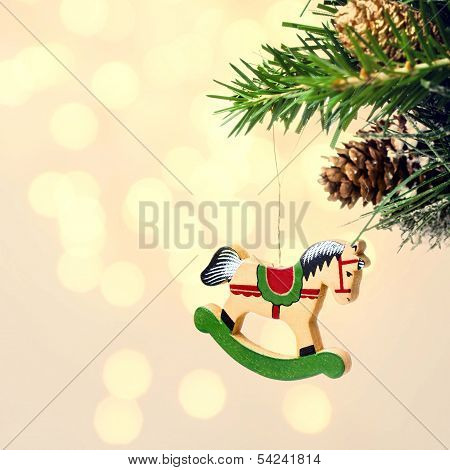 Christmas Card With Wooden Hourse On Fir Branches With Snow Decorations On Festive Lights Background