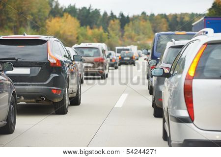 cars in traffic jam in a highway during rush hour