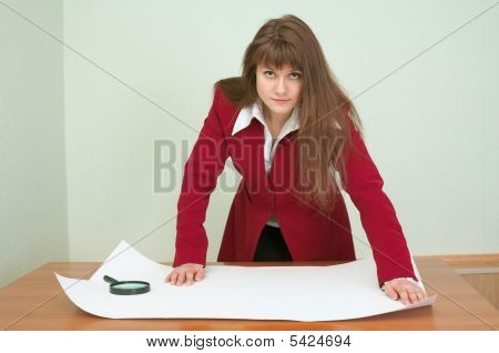 Business Woman Was Inclined Over The Plan
