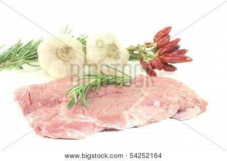 Raw Ribeye Steak With Garlic And Rosemary