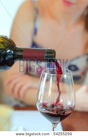 Red Wine Is Pouring Into Wine Glass