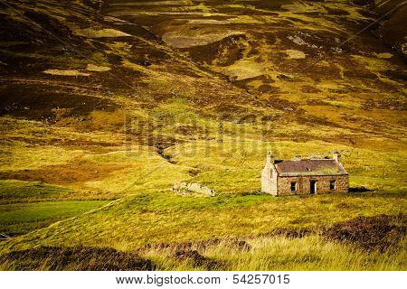 Little abandoned stone house in a middle of a mountain in the Cairngorms, Scotland, UK.