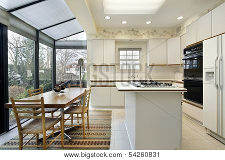 Kitchen with island and sliding doors to patio