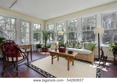 Sunroom in suburban home with red brick flooring