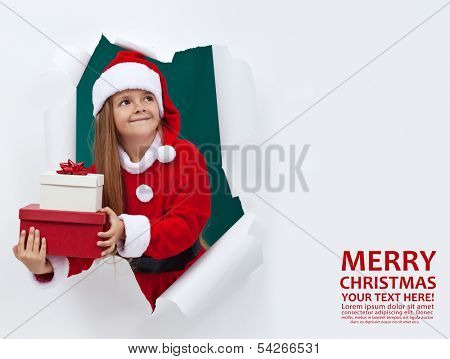 Joyful christmas with lots of presents - happy girl holding gift boxes, with copy space