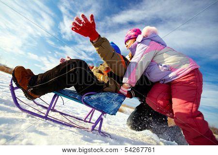 Friendly kids in winterwear having happy time outside