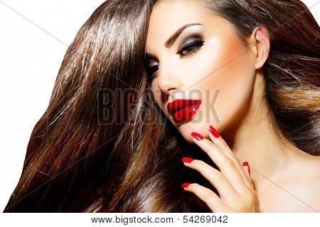 Sexy Beauty Girl with Red Lips and Nails. Provocative Make up. Luxury Woman with Long Brown Smooth Hair. Fashion Brunette Portrait isolated on a white background. Gorgeous Woman Face.