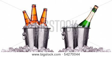 Beer and champagne bottles in ice bucket