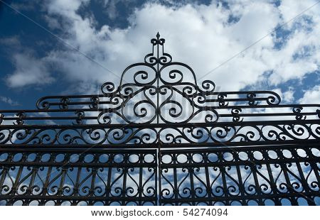 Old Wrought Iron Fence and Blue Sky