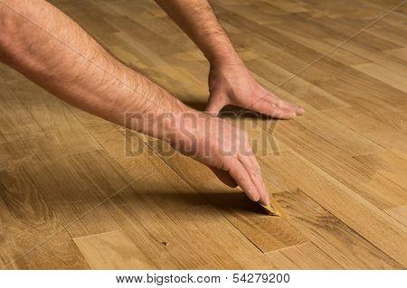 Filling the wooden floor.