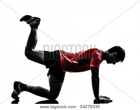 one man exercising fitness workout plank position in silhouette on white background