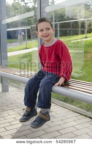 Child On Bus Stop