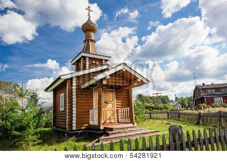 Small wooden Orthodox church in the Kindasovo village, Karelia, north of Russia