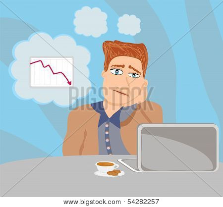 Sad And Thoughtful Businessman Sitting And Using A Laptop