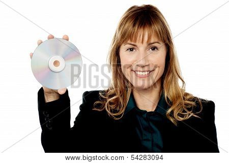 Female Manager Showing Compact Disc