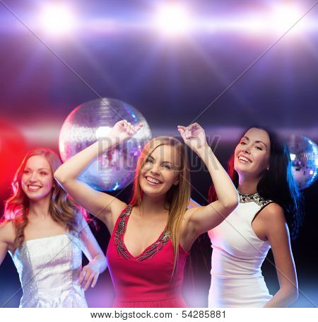 party, new year, celebration, friends, bachelorette party, birthday concept - three beautiful woman in evening dresses dancing in the club