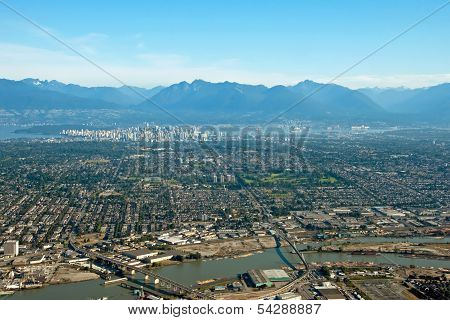 Aerial View Of Vancouver Downtown City In British Columbia With Beautiful Mountains In Background