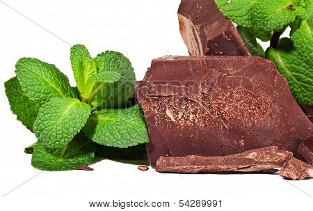Heap Of Delicious Black Chocolate With Mint Closeup
