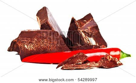 Heap Of Delicious Black Chocolate With Red Chili Pepper
