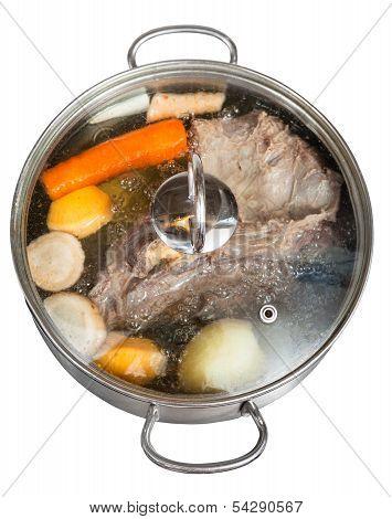 Simmer Of Beef Broth In Steel Pan