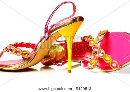 Yellow And Pink Heels On White Background
