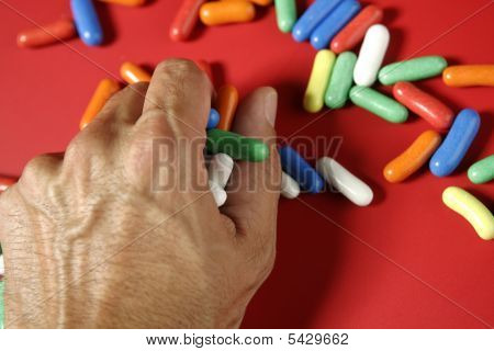 Colorful Candy On Vivid Red Background