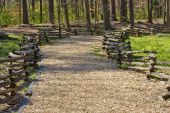 foto of split rail fence  - A natural trail in a forest park made of wood chips and a split rail fence - JPG