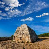 image of megaliths  - Menorca Ciutadella Naveta des Tudons megalithic chamber tomb In Balearic islands - JPG