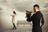 image of cun  - cunning man going to meeting and holding flowers and knife - JPG