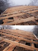 stock photo of rafters  - General view of the wooden rafters in the roof construction in foggy weather - JPG